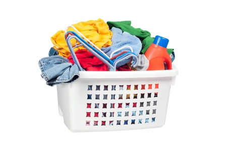 hangers: A laundry basket full of dirty clothing, clothes hangers and laundry detergent.  Isolated on white for designer convenience.