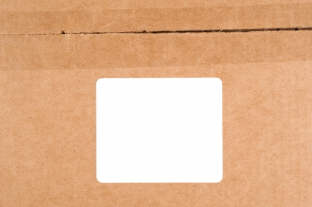 boxed: A blank white label on a cardboard box.  Users can add copy to the blank label. Stock Photo