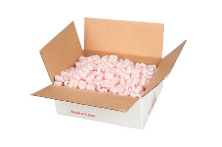 the padding: A white corrugated box filled with protective pink packaging peanuts that provides padding for the object being shipped. Stock Photo