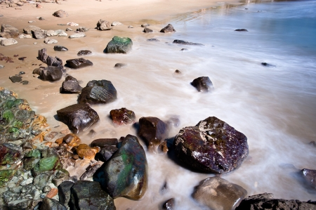 A rocky beach shoreline with blurred water motion in Laguna Beach,California. photo
