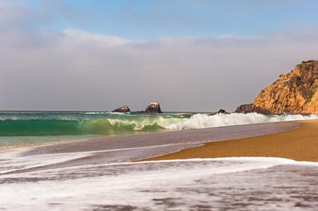 cove: Waves breaking along the shoreline of a small cove in Laguna Beach, California. Stock Photo