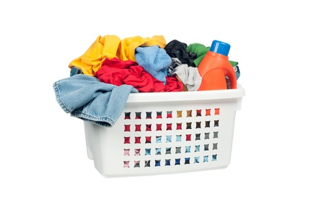 White laundry basket full of colorful clothing and a bottle of cleaning detergent. photo