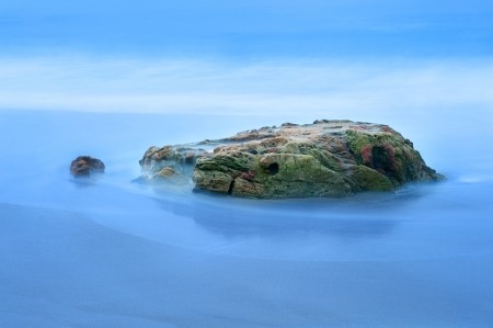 A beautiful slow motion exposure of sea water moving around a small reef in Laguna Beach, California Stock Photo - 19603859