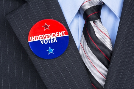An independent voter wears his party pin on his suit lapel Stock Photo