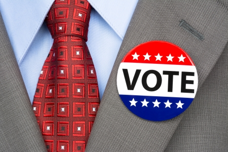 A voter wears a vote pin on his suit lapel during election season Stock Photo