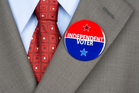 voter: Close up of an independent voting badge on the suit jacket lapel of an American voter.