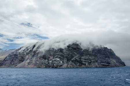 guadalupe island: Low clouds hug the remote island of Guadalupe in Mexico