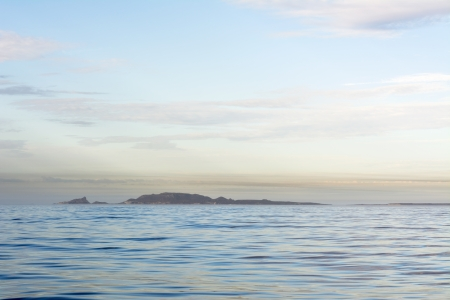 An early morning shot of Todos Santos Island in Mexico against a pastel, hazy sky Stock Photo - 22849322