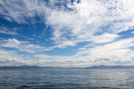 Beautiful clouds against a blue sky over the ocean in Mexico Stock Photo - 22849344