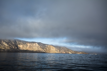 A dark, moody sky over Catalina Island in California during sunrise Stock Photo - 22849354