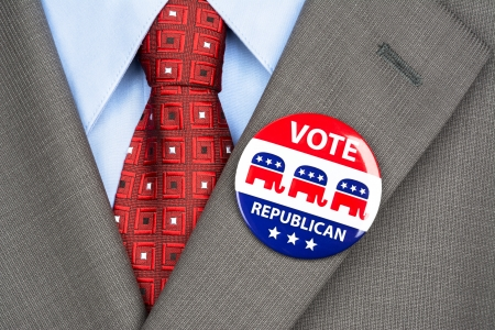 voter: Close up of a republican voting badge on the suit jacket lapel of an American voter. Stock Photo