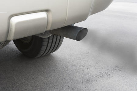 A car emitts carbon monoxide gas from its exhaust tailpipe, showing how pollution is formed.
