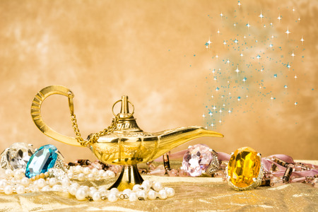 magic lamp: The formation of a magical deity from a gold, magic lamp surrounded by a wealth of jewelry and fantasy.