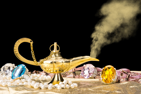 The formation of a magical deity from a gold, magic lamp surrounded by a wealth of jewelry and fantasy.