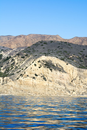 rugged terrain: A remote island in the Channel Islands of California shows the geology of rugged, diverse terrain framed against deep turquoise water and a vibrant blue sky.