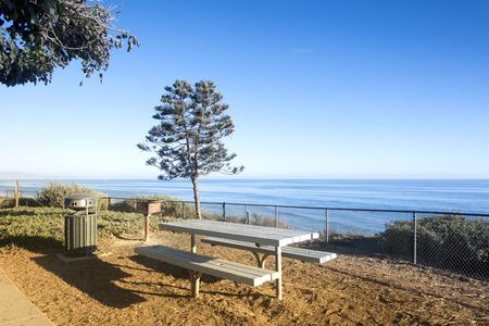santa barbara: A beautiful picnic area overlooking the ocean in Santa Barbara, California at days end when the sun is setting. Stock Photo