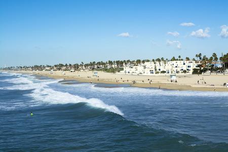 huntington beach: A panorama of the shoreline and sandy beach at historic Huntington Beach, California.