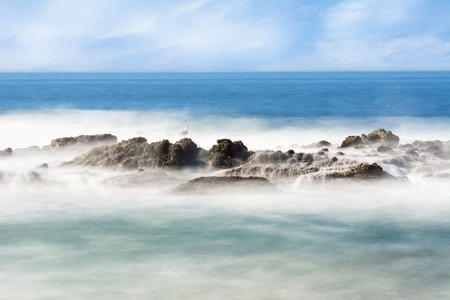 seawater: Slow motion scenic of a beautiful reef with seawater rushing over a rugged offshore reef in Laguna Beach, California.B