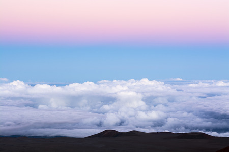 sky cloud: A classic pink inversion layer above a blue sky at 14,000 feet overlooking the top of the clouds. Stock Photo