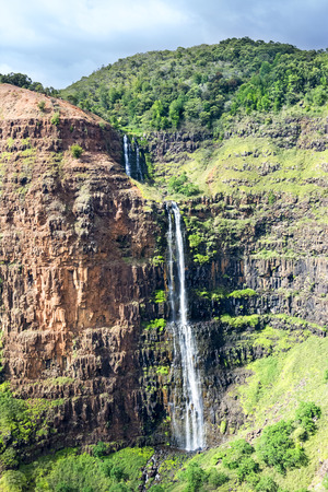 runoff: A cascading waterfall in the interior of Waimea Canyon, Kauai Hawaii photographed from a helicopter. Stock Photo