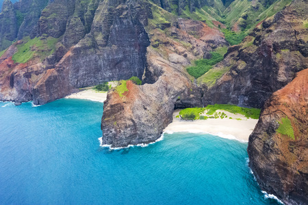 helicopter: An aerial view of the Na Pali coasts jutting cliffs at Honopu Valley during a helicopter tour of the coast.