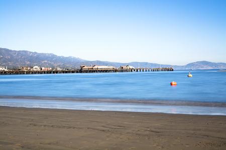 santa barbara: Image of a long exposure in Santa Barbara Harbor California with famous Stearns Wharf lining the blue water.
