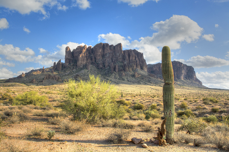 superstition: Famous Superstition Mountain in Arizona framed by a lone saguaro cactus shows the beauty of this dry desert landscape.
