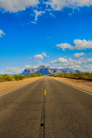 superstition: A long remote road leading to the base of famous Superstition Mountain in Arizona shows the beauty of this desert landscape. Stock Photo
