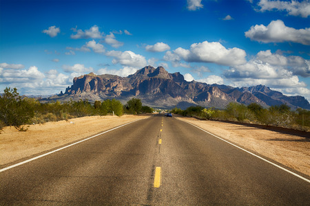 A long remote road leading to the base of famous Superstition Mountain in Arizona shows the beauty of this desert landscape. Stok Fotoğraf