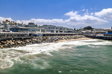 The Redondo Beach boardwalk in Southern California is lined with restaurants, housing and a nice beach. Banco de Imagens