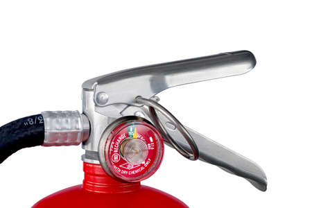 A classic red fire extinguisher valve isolated on a white background for use as a design element or safety inference for home and business protection.
