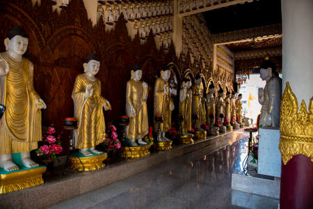 reverence: Gold draped Statues of Buddhas line a hallway in the kek Lok Si Temple complex Editorial