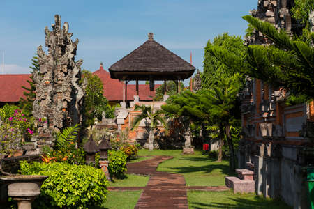 venerable: A pathway leading through a garden at the Royal Courts of Justice in Indonesia Stock Photo
