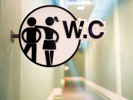 Close up WC sign in public toilet