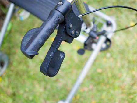 Close up handles of four wheel rollator walkers