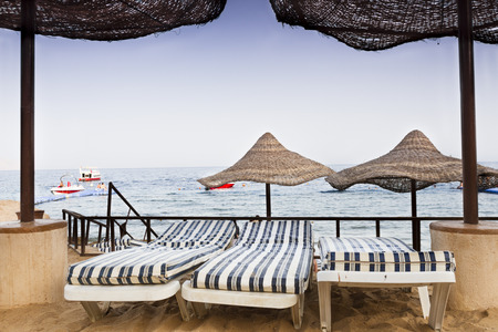 parasols: View of the sea framed by two parasols