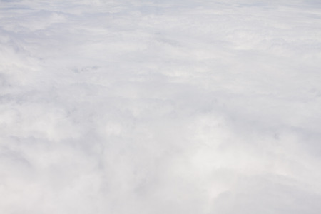 puffy: View of white puffy clouds from a plane window