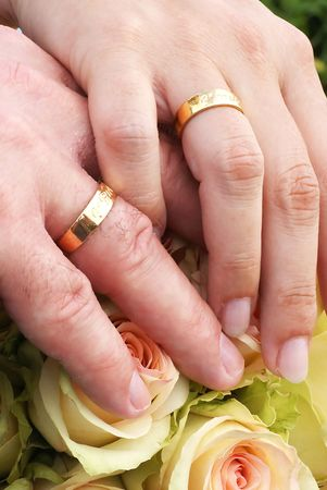Two hands with wedding rings photo