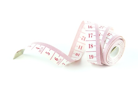 The tape measure used for making clothing alterations and to measure body  parts with white background. photo