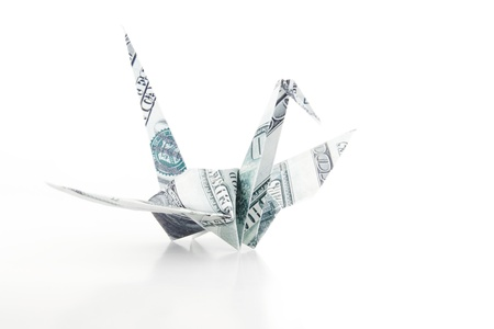 The Origami bird made from the dollar bank note photo