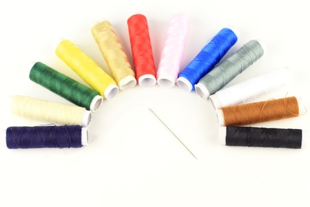 collocation: Close-up of the color threads and needle by semicircle collocation