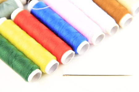 collocation: Close-up of the color threads and needle by oblique collocation Stock Photo