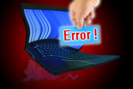 The laptop computer and  hand pick a label with word Error ! photo
