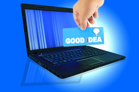 The laptop computer and  hand pick a label with word GOOD iDEA photo