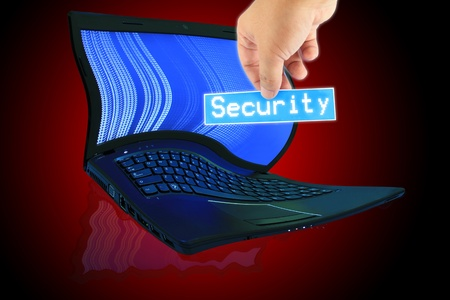 The laptop computer and  hand pick a label with word Security photo