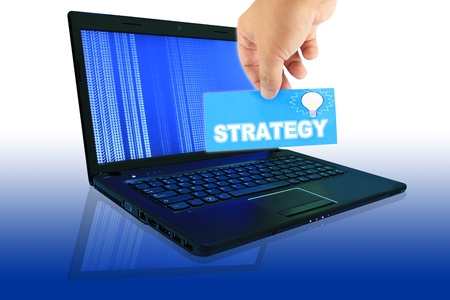 The laptop computer in progress and  Hand pick a label to write the word Stock Photo - 11174018