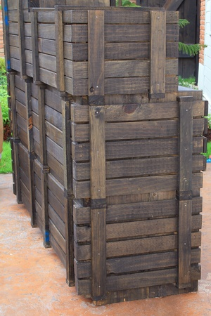 Wooden crates used to store wine bottles, stacked outside  photo
