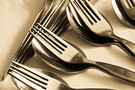 close-up of many pair of spoon and fork on table photo