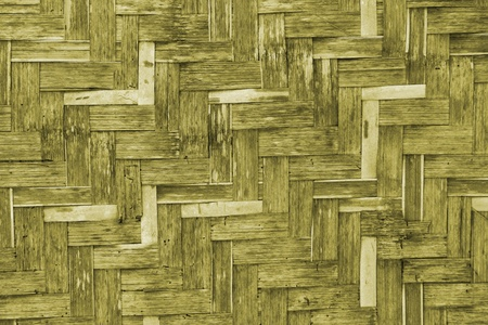 The old yellow bamboo wicker wall texture photo