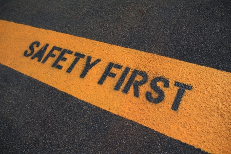 Safety First sign on caution strip.  photo